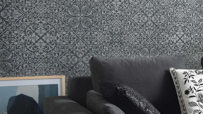 Wall design living room, non-woven wallpaper in graphite with detailed ornament pattern, grey modern couch