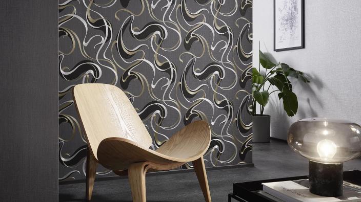 Vliestapete schwarz-silber mit grafischem Schlingenmuster