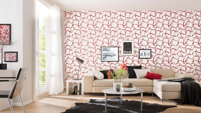 Modernes Wohnzimmer mit rot-weißer Tapete in grafischem Muster