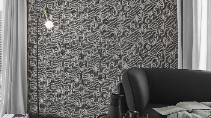 Vliestapete für Wohnzimmer mit edlen Glimmereffekten, schwarz-goldenes Wellenmotiv