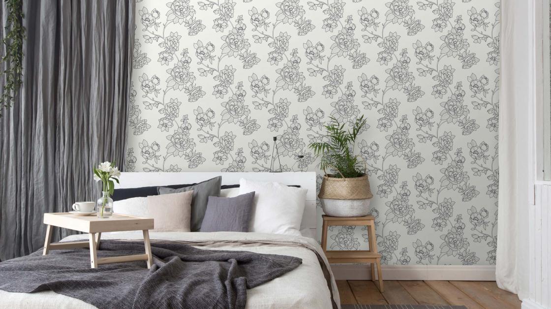 Vliestapete in schwarz-weiß mit romantischen Blütenmotiv
