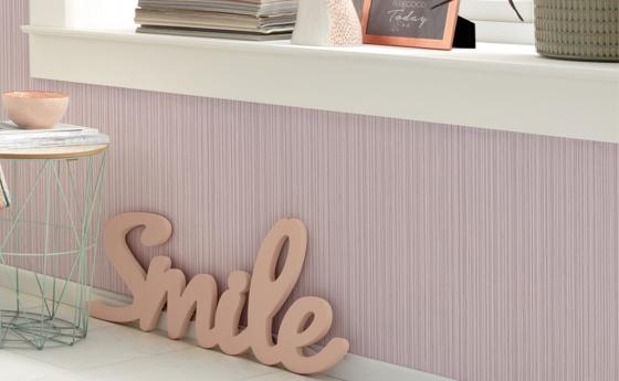 Wall design with pink non-woven wallpaper, unistructure with vertikelen fine stripes, decoration